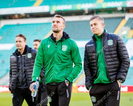 Hibernian players Christian Doidge & Fraser Murray on the pitch shortly after arriving at Celtic Park.
