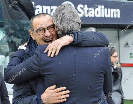 Juventus' coach Maurizio Sarri (L) embraces Udinese's coach Luca Gotti prior to the Italian Serie A soccer match Juventus FC vs Udinese Calcio at the Allianz Stadium in Turin, Italy, 15 December 2019.