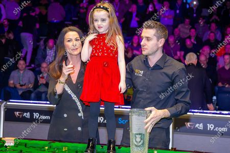 Stock Photo of The 19.com World Snooker Scottish Open Champion 2019 Mark Selby, alongside his partner Vikki & his daughter Sofia with the Stephen Hendry Trophy following his win at the World Snooker 19.com Scottish Open Final Mark Selby vs Jack Lisowski at the Emirates Arena, Glasgow