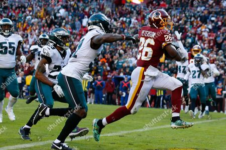 Week 15. Washington Redskins running back Adrian Peterson (26) runs past Philadelphia Eagles free safety Rodney McLeod (23) and cornerback Jalen Mills (31) to score a touchdown in the second half of an NFL football game, in Landover, Md