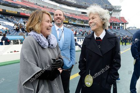 Tennessee Titans owner Amy Adams Strunk, left, talks with Houston Texans owner Janice McNair, right, before an NFL football game, in Nashville, Tenn