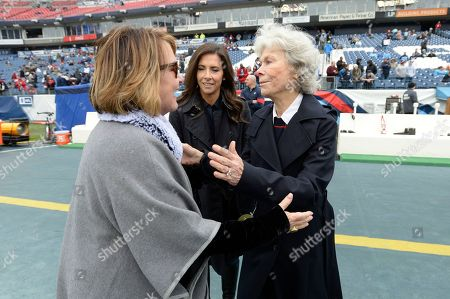 Tennessee Titans owner Amy Adams Strunk, left, greets Houston Texans owner Janice McNair, right, before an NFL football game, in Nashville, Tenn