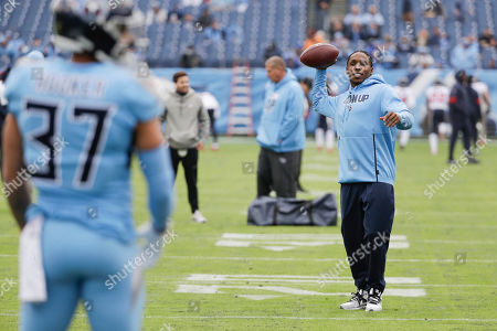 Injured Tennessee Titans cornerback Adoree' Jackson, right, throws a ball before an NFL football game against the Houston Texans, in Nashville, Tenn