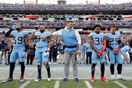 Tennessee Titans head coach Mike Vrabel stands with Wesley Woodyard (59), Jurrell Casey (99), Kevin Byard (31) and Adoree' Jackson (25) for the national anthem before an NFL football game between the Titans and the Houston Texans, in Nashville, Tenn