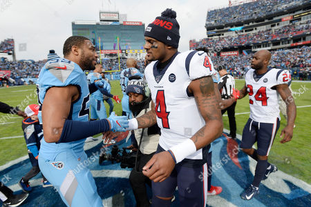 Tennessee Titans inside linebacker Wesley Woodyard (59) and Houston Texans quarterback Deshaun Watson (4) shake hands before an NFL football game, in Nashville, Tenn
