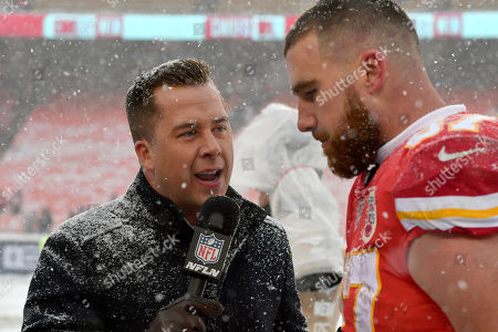 NFL Network's James Palmer interviews Kansas City Chiefs tight end Travis Kelce (87) following an NFL football game against the Denver Broncos in Kansas City, Mo., . The Kansas City Chiefs won 23-3