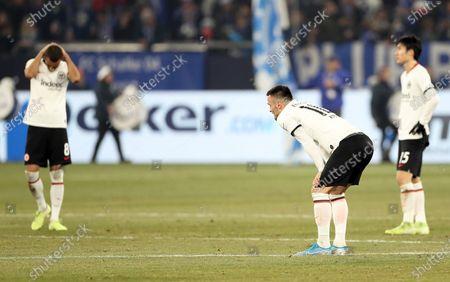 Eintracht Frankfurt players (L-R) Djibril Sow, Filip Kostic, and Daichi Kamada react after losing the German Bundesliga soccer match between FC Schalke 04 and Eintracht Frankfurt in Gelsenkirchen, Germany, 15 December 2019.