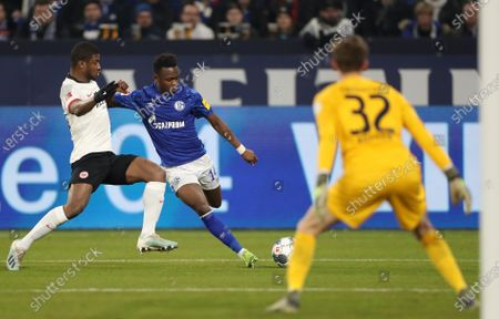 Frankfurt's Almamy Toure (L) and Frankfurt's goalkeeper Frederik Ronnow (R) in action with Schalke's Rabbi Matondo (C) during the German Bundesliga soccer match between FC Schalke 04 and Eintracht Frankfurt in Gelsenkirchen, Germany, 15 December 2019.