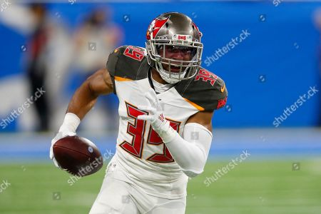 Tampa Bay Buccaneers strong safety Andrew Adams (39) returns an interception during an NFL football game against the Detroit Lions in Detroit