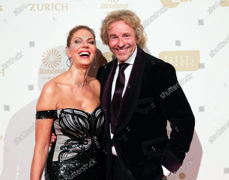 German radio host Thomas Gottschalk (R) with partner Karina Mross (L) attend the Athlete of the Year 2019 Award (Sportler des Jahres) ceremony at the Kurhaus in Baden-Baden, Germany, 15 December 2019.