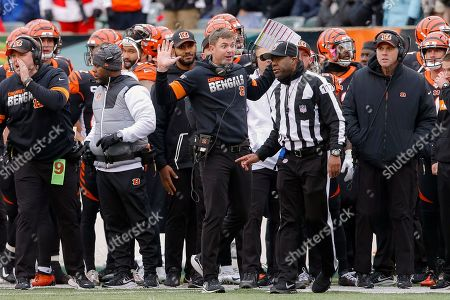 Stock Image of Cincinnati Bengals head coach Zac Taylor, center, reacts to a play call resulting in a New England Patriots fumble recovery off wide receiver Alex Erickson in the first half of an NFL football game, in Cincinnati