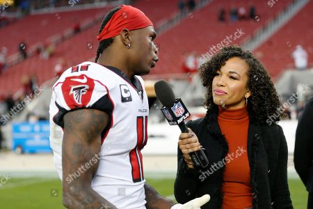 Atlanta Falcons wide receiver Julio Jones, left, is interviewed by reporter MJ Acosta after an NFL football game between the San Francisco 49ers and the Falcons in Santa Clara, Calif