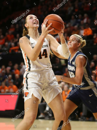 Taylor Jones, Hailey Bassett. Oregon State's Taylor Jones, left, shots ahead of Utah State's Hailey Bassett, right, during the third quarter of an NCAA college basketball game in Corvallis, Ore