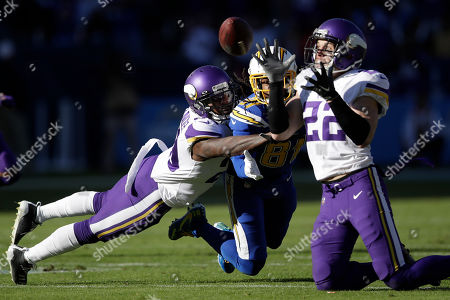 Los Angeles Chargers wide receiver Mike Williams, center, looks on as a pass is intercepted by Minnesota Vikings free safety Harrison Smith, right, while Minnesota Vikings cornerback Mackensie Alexander, left, defends during the first half of an NFL football game, in Carson, Calif