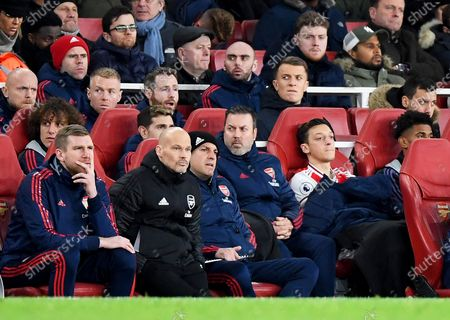 Arsenal's interim manager Freddie Ljungberg (2-L) sits on the bench next to assistant manager Per Mertesacker (L) and Mesut Oezil (2-R) during the English Premier League soccer match between Arsenal FC and Manchester City in London, Britain, 15 December 2019.