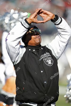 Stock Photo of MC Hammer during ceremonies before an NFL football game between the Oakland Raiders and the Jacksonville Jaguars in Oakland, Calif