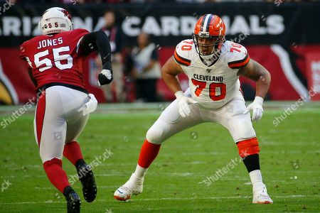 Cleveland Browns offensive tackle Kendall Lamm (70) lines up against Arizona Cardinals linebacker Chandler Jones (55) during the first half of an NFL football game, in Glendale, Ariz