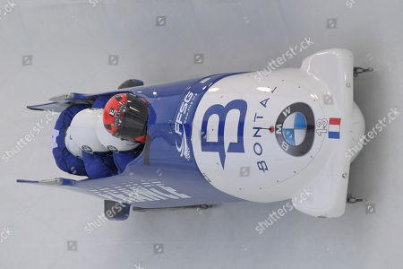 Romain Heinrich, Alan Alais, Dorian Hauterville, Jerome Laporal. Driver Romain Heinrich, Alan Alais, Dorian Hauterville, and brakeman Jerome Laporal of France take a turn during the first run of the four-man bobsled World Cup race, in Lake Placid, N.Y., on