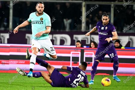 Inter's Danilo D'Ambrosio (L) in action against Fiorentina's Dalbert (C) during the Italian Serie A soccer match between ACF Fiorentina and Inter Milan at the Artemio Franchi stadium in Florence, Italy, 15 December 2019.
