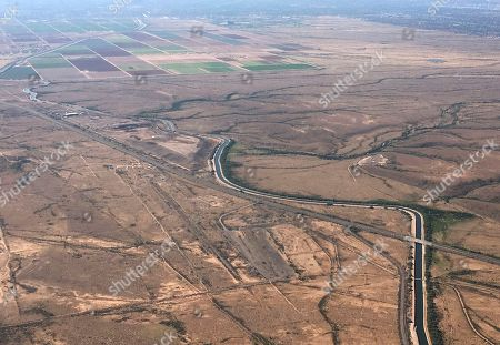 Stock Image of The Central Arizona Project canal runs through rural desert near Phoenix. After six weeks of having parts of the Central Arizona Project canal being dry in order to do $6 million in repairs, Colorado River water will be flowing again the week of Dec. 16