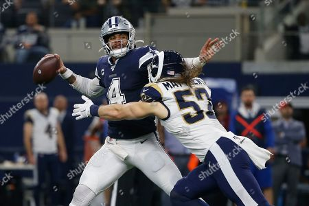 Dallas Cowboys quarterback Dak Prescott (4) passes under pressure from Los Angeles Rams outside linebacker Clay Matthews (52) in the first half of an NFL football game in Arlington, Texas