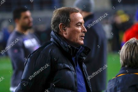 Stock Photo of NBC announcer Al Michaels stands on the sidelines during warm ups before an NFL football game between the Pittsburgh Steelers and the Buffalo Bills in Pittsburgh