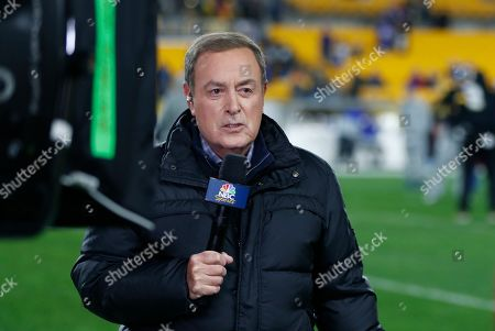 NBC Sports Reporter Al Michaels reports from the sidelines during warm ups before an NFL football game between the Pittsburgh Steelers and the Buffalo Bills in Pittsburgh
