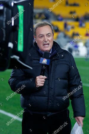 Stock Image of NBC Sports Reporter Al Michaels reports from the sidelines during warm ups before an NFL football game between the Pittsburgh Steelers and the Buffalo Bills in Pittsburgh