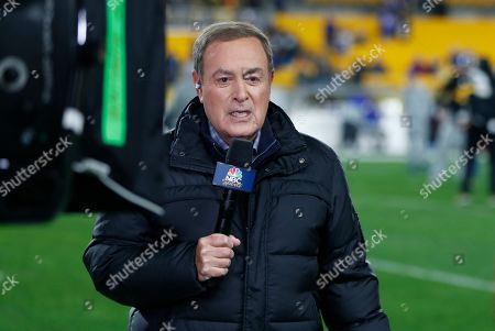 Stock Picture of NBC Sports Reporter Al Michaels reports from the sidelines during warm ups before an NFL football game between the Pittsburgh Steelers and the Buffalo Bills in Pittsburgh