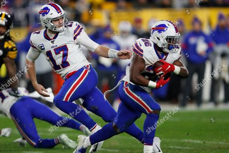 Buffalo Bills quarterback Josh Allen (17) hands off to running back Devin Singletary (26) during the first half of an NFL football game against the Pittsburgh Steelers in Pittsburgh,. The Bills won 17-10