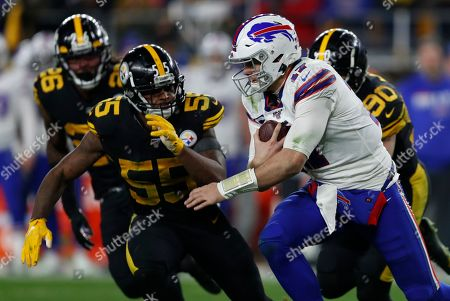 Pittsburgh Steelers linebacker Devin Bush (55) pursues Buffalo Bills quarterback Josh Allen (17) during the second half of an NFL football game in Pittsburgh