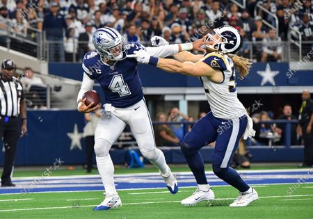 Dallas Cowboys quarterback Dak Prescott #4 gives a stiff arm to Los Angeles Rams outside linebacker Clay Matthews #52 in the first quarter for a first down during an NFL game between the Los Angeles Rams and the Dallas Cowboys at AT&T Stadium in Arlington, TX Albert Pena/CSM