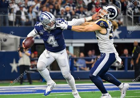 Stock Picture of Dallas Cowboys quarterback Dak Prescott #4 gives a stiff arm to Los Angeles Rams outside linebacker Clay Matthews #52 in the first quarter for a first down during an NFL game between the Los Angeles Rams and the Dallas Cowboys at AT&T Stadium in Arlington, TX Albert Pena/CSM