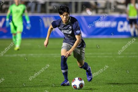 Georgetown's Daniel Wu handles the ball during the NCAA college soccer championship against Virginia in Cary, N.C
