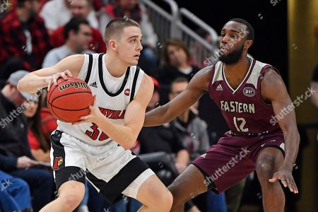 Stock Photo of Louisville guard Ryan McMahon (30) looks for help from the defense of Eastern Kentucky guard Ty Taylor II (12) during the first half of an NCAA college basketball game in Louisville, Ky