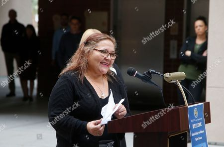 Stock Photo of Lala Vasquez smiles as she talks about her new home during an open house ceremony at Native American Connections Urban Living on Fillmore affordable housing unit, in Phoenix. The just-opened 64-unit building has already reached full occupancy