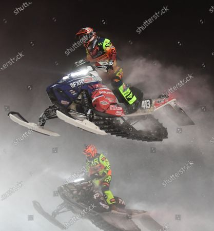 Stock Picture of Professional Pro Lite Snocross racer Evan Daudt (413) leads Professional Pro Lite Snocross racer Taylor Cole (714) in a race at the Country Cat SnoCross National, an ISOC Amsoil Championship SnoCross event, held at Buffalo River Race Park, Glyndon, MN