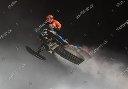 Stock Image of Professional Pro Lite Snocross racer Jay Lura competes at the Country Cat SnoCross National, an ISOC Amsoil Championship SnoCross event, held at Buffalo River Race Park, Glyndon, MN