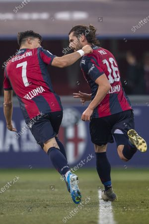 Stock Image of Andrea Poli (Bologna) Riccardo Orsolini (Bologna) celebrates after scoring his team's second goal