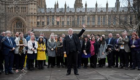Leader of the Scottish National Party (SNP) in the House of Commons, Ian Blackford (C) gestures in front of SNP's Members of Parliament (MPs), outside parliament in Westminster, London, Britain, 16 December 2019. The SNP won 47 seats in Scotland in last week's general election.