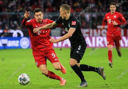 Robert Lewandowski (L) of Bayern Munich vies with Ludwig Augustinsson (C) of Bremen during a German Bundesliga match between FC Bayern Munich and SV Werder Bremen