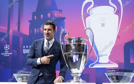 Former Portuguese player Luis Figo poses with the Champions League trophy during the UEFA Champions League 2019/20 round of 16 draw ceremony at the UEFA Headquarters in Nyon, Switzerland, 16 December 2019.