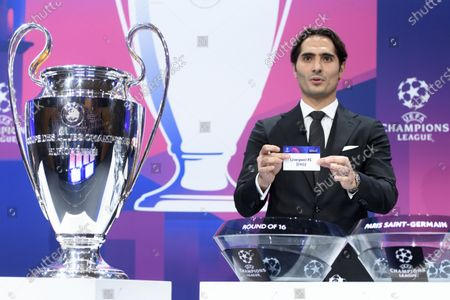 Turkish soccer player Hamit Altintop shows the lot of Britain's soccer club Liverpool FC during the UEFA Champions League 2019/20 round of 16 draw ceremony at the UEFA Headquarters in Nyon, Switzerland, 16 December 2019.