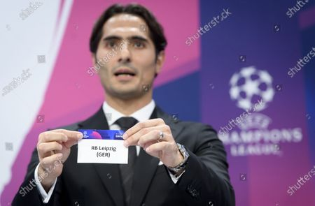 Turkish soccer player Hamit Altintop shows the lot of Germany's soccer club RB Leipzig during the UEFA Champions League 2019/20 round of 16 draw ceremony at the UEFA Headquarters in Nyon, Switzerland, 16 December 2019.