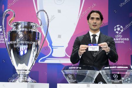 Turkish soccer player Hamit Altintop shows the lot of Spain's soccer club FC Barcelona, during the UEFA Champions League 2019/20 round of 16 draw ceremony at the UEFA Headquarters in Nyon, Switzerland, 16 December 2019.