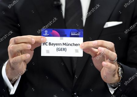 Turkish soccer player Hamit Altintop shows the lot of Germany's soccer club FC Bayern Muenchen during the UEFA Champions League 2019/20 round of 16 draw ceremony at the UEFA Headquarters in Nyon, Switzerland, 16 December 2019.