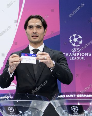 Stock Image of Turkish soccer player Hamit Altintop shows the lot of France's soccer club Paris Saint-Germain during the UEFA Champions League 2019/20 round of 16 draw ceremony at the UEFA Headquarters in Nyon, Switzerland, 16 December 2019.