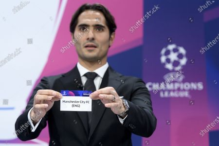 Stock Picture of Turkish soccer player Hamit Altintop shows the lot of England's soccer club Manchester City FC during the UEFA Champions League 2019/20 round of 16 draw ceremony at the UEFA Headquarters in Nyon, Switzerland, 16 December 2019.