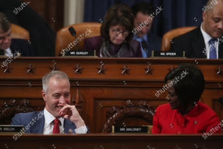 United States Representative Sean Patrick Maloney (Democrat of New York), left, and US Representative Terri Sewell (Democrat of Alabama), right, chat during a House Intelligence Committee hearing as part of the impeachment inquiry into U.S. President Donald Trump on Capitol Hill in Washington, U.S..
