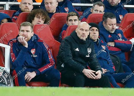 LONDON, United Kingdom, .L-R Interim First-team Assistant Head Coach Per Mertesacker, Interim Head Coach Freddie Ljungberg and Steve Bould (Black Hat) during English Premier League between Arsenal and Manchester City at Emirates stadium , London, England on 15 December 2019. (Photo by AFS/Espa-Images)